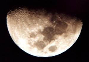 The moon shot with a Canon EOS Rebel held in front of the eyepiece of a TAL-1 reflector. Shot in 1992 on Kodak Ektar 1000.