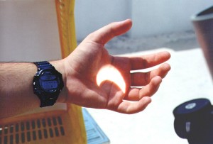 Solar eclipse - August 11th 1999 (14:44 as you can see on my Casio Cosmo Phase watch). The eclipse is nearing maximum for Athens. Projected from my TAL-1 reflector.