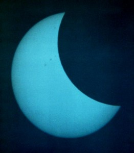 Solar eclipse - August 11th 1999 from Athens. Some sunspots visible. Projected on a sheet of paper from my TAL-1 reflector. Blue-2 filter used.